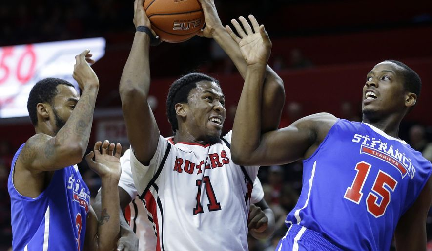 Rutgers' Kadeem Jack (11) tries to control the ball as St. Francis Brooklyn's Chris Hooper (15) and Antonio Jenifer (3) defend during the first half of an NCAA college basketball game Sunday, Nov. 23, 2014, in Piscataway, N.J. (AP Photo/Mel Evans)