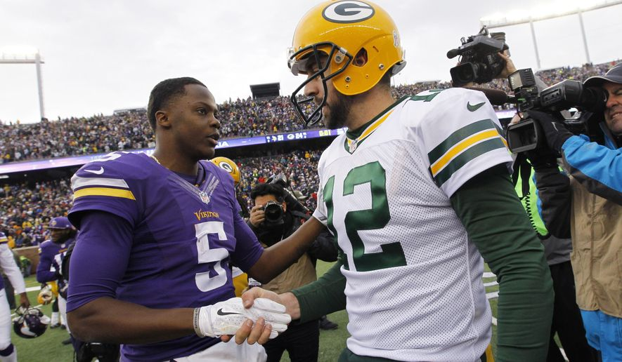 Minnesota Vikings quarterback Teddy Bridgewater, left, talks with Green Bay Packers quarterback Aaron Rodgers after an NFL football game, Sunday, Nov. 23, 2014, in Minneapolis. The Packers won 24-21. (AP Photo/Ann Heisenfelt)