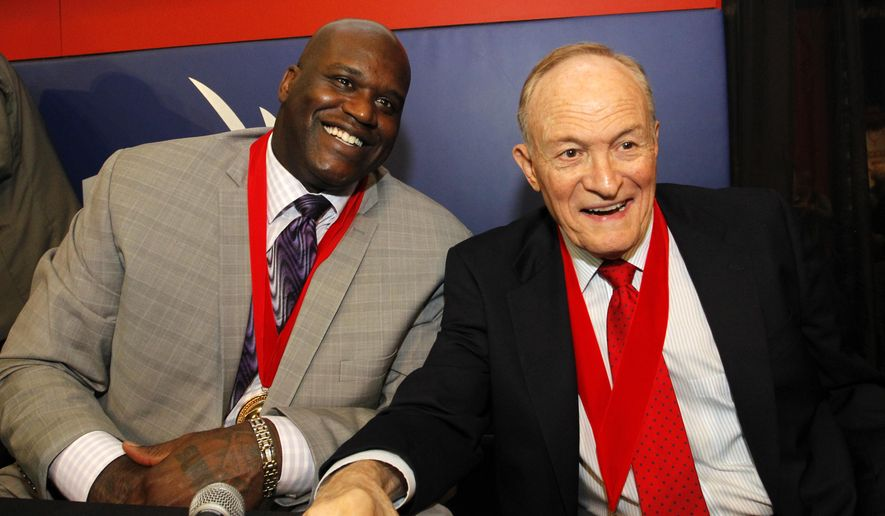 Former Louisiana State player Shaquille O'Neal, left, and former LSU basketball coach Dale Brown, right, talk about their careers during a news conference before a National Collegiate Basketball Hall of Fame induction event, Sunday, Nov. 23, 2014, in Kansas City, Mo. (AP Photo/Colin E. Braley)