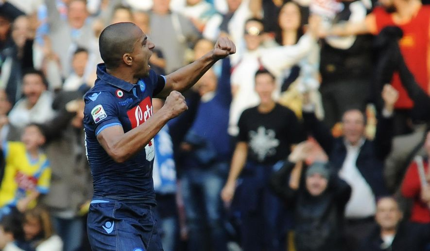 Napoli's Gokhan Inler celebrates after scoring during a Serie A soccer match between Napoli and Cagliari, at the San Paolo stadium in Naples, Italy, Sunday, Nov. 23, 2014. (AP Photo/Gennaro Giorgio)