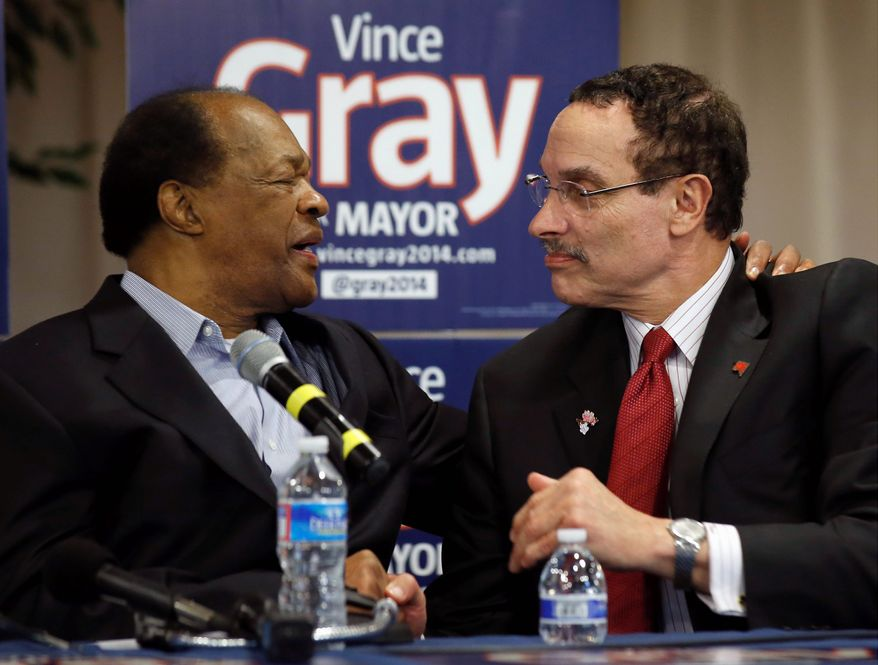 D.C. Council member Marion Barry embraces Mayor Vincent C. Gray during a media availability to announce Mr. Barry's endorsement of Mr. Gray's bid for re-election on March 19, 2014. (Associated Press/Alex Brandon)