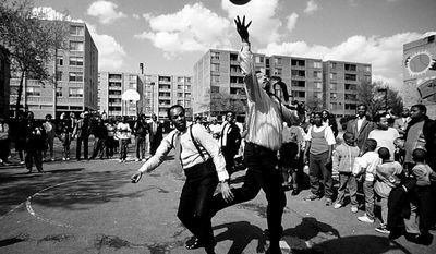 Former Mayor Marion Barry and Jesse Jackson Jr. playing basketball in a D.C. housing project in April 18, 1989 (Kevin T. Gilbert/The Washington Times)