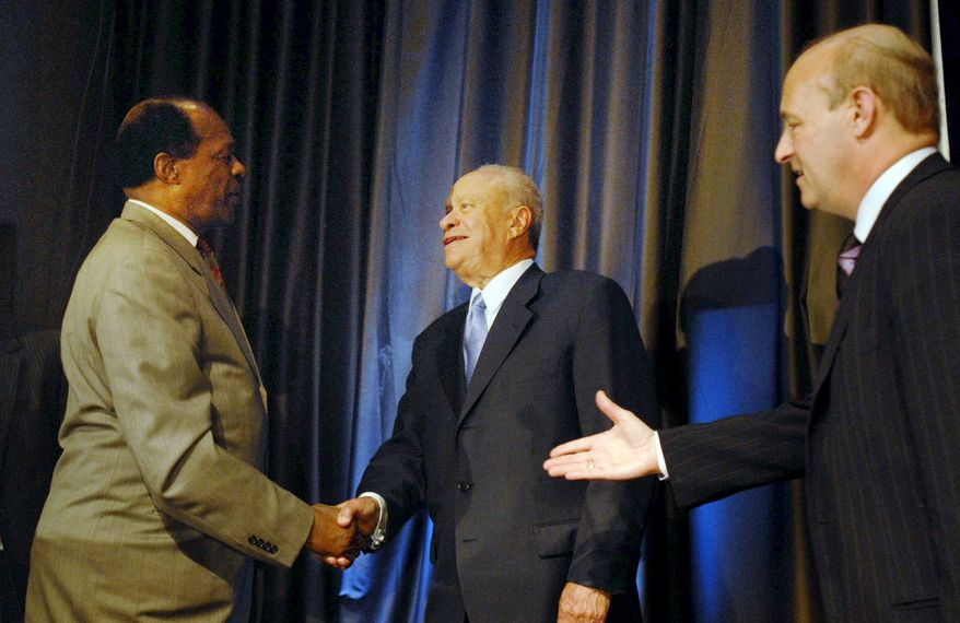 D.C. Council member Marion Barry shakes hands with newly announced Washington Nationals Owner Theodore Lerner of the Lerner Group, after the announcement that the Lerners had been selected as owners of the Washington Nationals on May 3, 2006. (Saul McSween/The Washington Times)