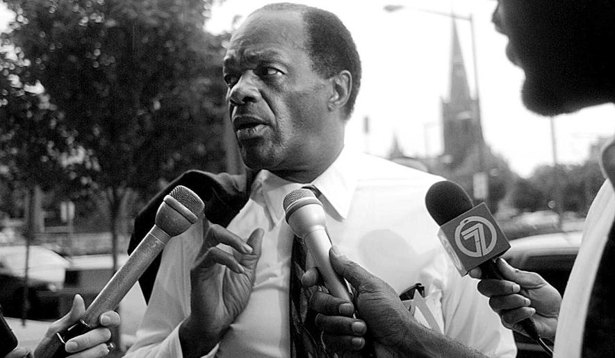 Mayor Marion Barry arrives at a meeting of the Financial Control Board at the headquarters on Thomas Circle in Northwest on June 10, 1996. (Kevin T. Gilbert/The Washington Times)