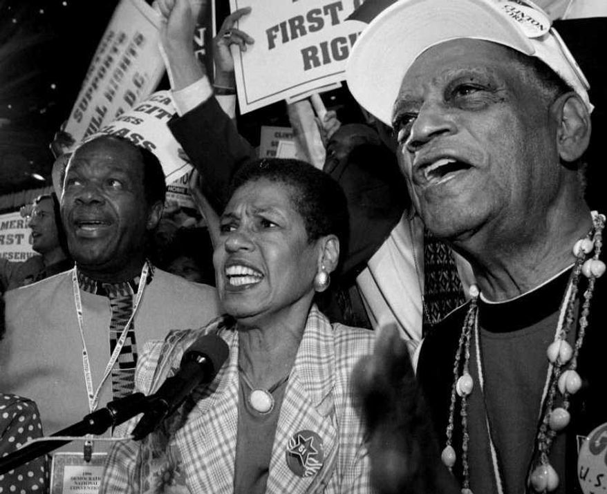 D.C. Delegate Eleanor Holmes Norton, with Marion Barry at left and D.C. Council member Harry Thomas at right, casts the city delegations votes for President Clinton on Aug. 28, 1996 at the Democratic National Convention in Chicago. (Cliff Owen/The Washington Times)