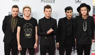 Liam Payne, from left, Niall Horan, Louis Tomlinson, Zayn Malik and Harry Styles of the musical group One Direction arrive at the 42nd annual American Music Awards at Nokia Theatre L.A. Live on Sunday, Nov. 23, 2014, in Los Angeles. (Photo by Jordan Strauss/Invision/AP)