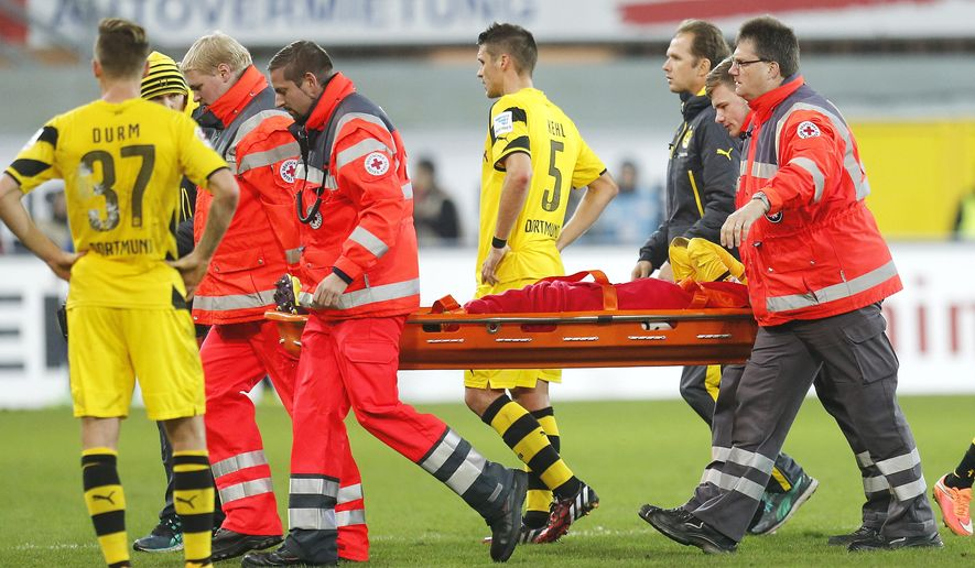 Dortmund's Marco Reus is carried off the pitch on a stretcher during the German first division Bundesliga soccer match between SC Paderborn 07 and Borussia Dortmund in Paderborn, Germany, Saturday, Nov.22, 2014. (AP Photo/Michael Probst)
