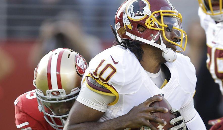 Washington Redskins quarterback Robert Griffin III (10) is sacked by San Francisco 49ers linebacker Aldon Smith during the first quarter of an NFL football game in Santa Clara, Calif., Sunday, Nov. 23, 2014. (AP Photo/Ben Margot)