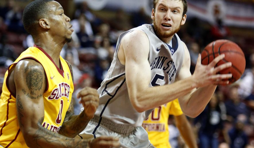 Penn State's Donovon Jack, right, goes up to shoot against Southern California's Darion Clark, left, in the first half at the Charleston Classic NCAA college basketball tournament in Charleston, S.C., Sunday, Nov. 23, 2014. (AP Photo/Mic Smith)