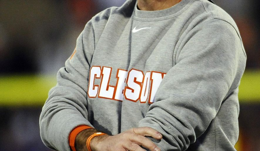 Clemson head coach Dabo Swinney looks on from the sideline during the second half of an NCAA college football game against Georgia State, Saturday, Nov. 22, 2014, in Clemson, S.C. Clemson won 28-0. (AP Photo/Rainier Ehrhardt)