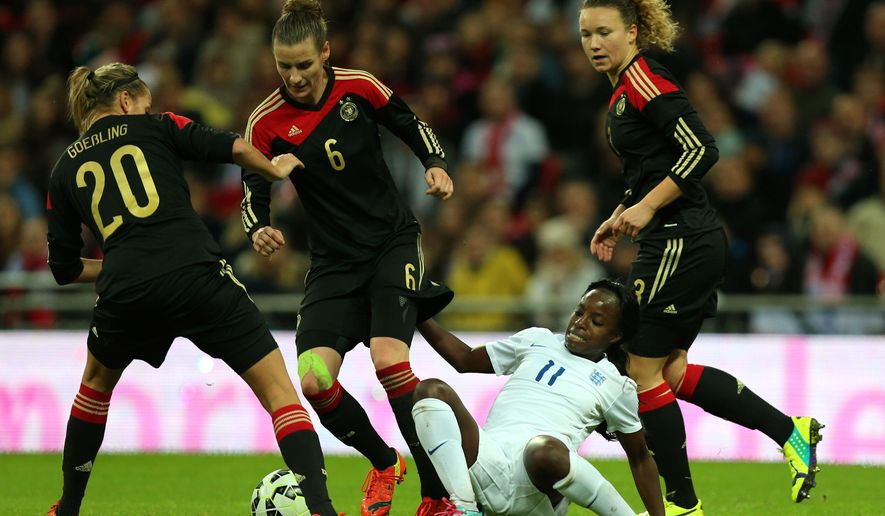 England's Eniola Aluke, below, fights for the ball with Germany's Lena Goebling, left, Simone Laudehr, second left, and Josephine Henning during the International Friendly women's soccer match at Wembley Stadium, London, Sunday, Nov. 23, 2014. (AP Photo/Mike Egerton, PA Wire)    UNITED KINGDOM OUT    -   NO SALES    -   NO ARCHIVES