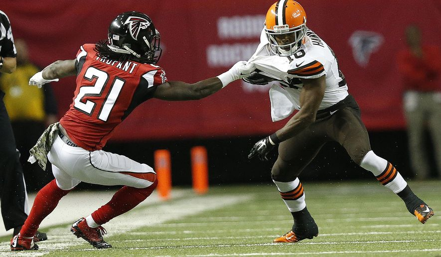 Atlanta Falcons cornerback Desmond Trufant (21) grabs Cleveland Browns wide receiver Andrew Hawkins (16) during the first half of an NFL football game, Sunday, Nov. 23, 2014, in Atlanta. (AP Photo/Brynn Anderson)