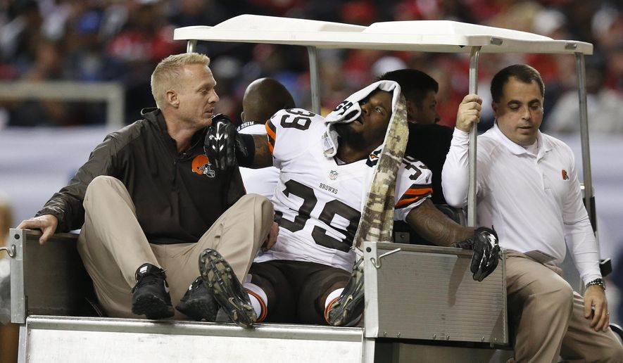 Cleveland Browns free safety Tashaun Gipson (39) is taken off the field after being injured against the Atlanta Falcons during the second half of an NFL football game, Sunday, Nov. 23, 2014, in Atlanta. (AP Photo/Brynn Anderson )