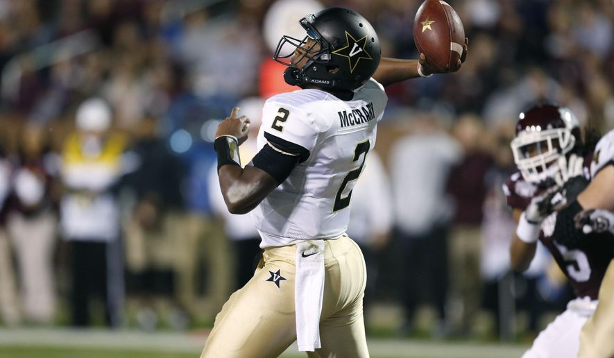 Vanderbilt quarterback Johnny McCrary (2) passes against Mississippi State in the second half of an NCAA college football game Saturday, Nov. 22, 2014, in Starkville, Miss. No. 4 Mississippi State won 51-0. (AP Photo/Rogelio V. Solis)
