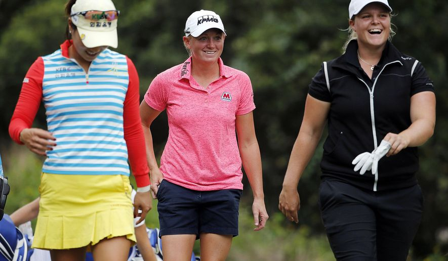 Hee Young Park of Korea, left, Stacy Lewis, center, and Caroline Hedwall of Sweden laugh while making their way to hole 7  during the second round of the LPGA's CME Group Tour Championship golf tournament, Saturday, Nov. 22, 2014 at Tiburon Golf Club in Naples, Fla.. (AP Photo/Naples Daily News, Corey Perrine) FORT MYERS OUT