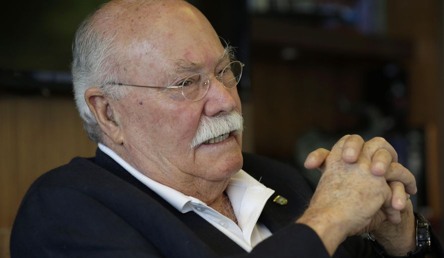 In this Wednesday, Oct. 22, 2014 photo, Cuban exile Gustavo Villoldo, 78, talks during an interview in his lawyer's office in Miami. Villoldo and families of two men allegedly killed by the Cuban government are moving closer to collecting billions of dollars linked to the Cuban government. (AP Photo/Lynne Sladky)