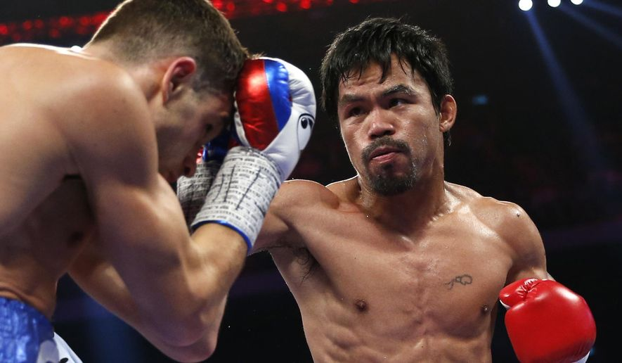WBO welterweight champion Manny Pacquiao of the Philippines  and WBO junior welterweight champion Chris Algieri of the U.S., left, exchange punches during their world welterweight title boxing match at the Venetian Macao in Macau, Sunday, Nov. 23, 2014. Pacquiao got the big knockdowns he so desperately craved, battering Algieri around the ring at will Sunday on his way to a decision win in one of the most lopsided welterweight title fights imaginable. (AP Photo/Kin Cheung)