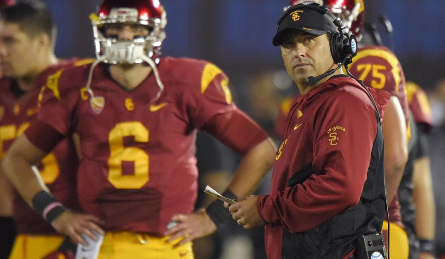 Southern California coach Steve Sarkisian, right, stands near quarterback Cody Kessler during the first half of an NCAA college football game against UCLA, Saturday, Nov. 22, 2014, in Pasadena, Calif. UCLA won 38-20. (AP Photo/Mark J. Terrill)