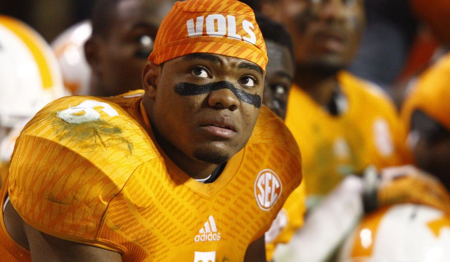 Tennessee defensive back Todd Kelly Jr. (6) watches the jumbotron in the fourth quarter of an NCAA college football game against Missouri Saturday, Nov. 22, 2014 in Knoxville, Tenn. Missouri  won 29-21. (AP Photo/Wade Payne)