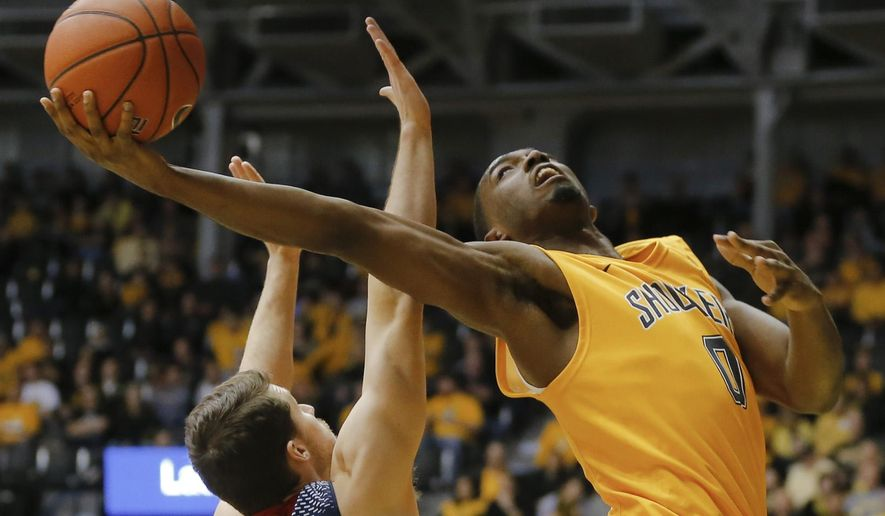 Wichita State's Rashard Kelly, right, takes a shot against Newman University's Nathan Veenis during the second half of an NCAA college basketball game in Wichita, Kan., on Sunday, Nov. 23, 2014. (AP Photo/The Wichita Eagle, Travis Heying) LOCAL STATIONS OUT; MAGS OUT; LOCAL RADIO OUT; LOCAL INTERNET OUT