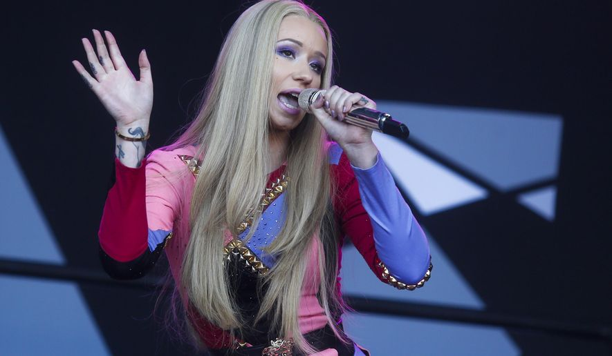 """FILE - In this Oct. 4, 2014 file photo, Iggy Azalea performs at the Austin City Limits Music Festival in Austin, Texas. Azalea, from Australia, is the lead nominee at Sunday's American Music Awards. She will compete for top awards such as artist, new artist and single of the year for her smash hit, """"Fancy."""" (Photo by Jack Plunkett/Invision/AP, File)"""