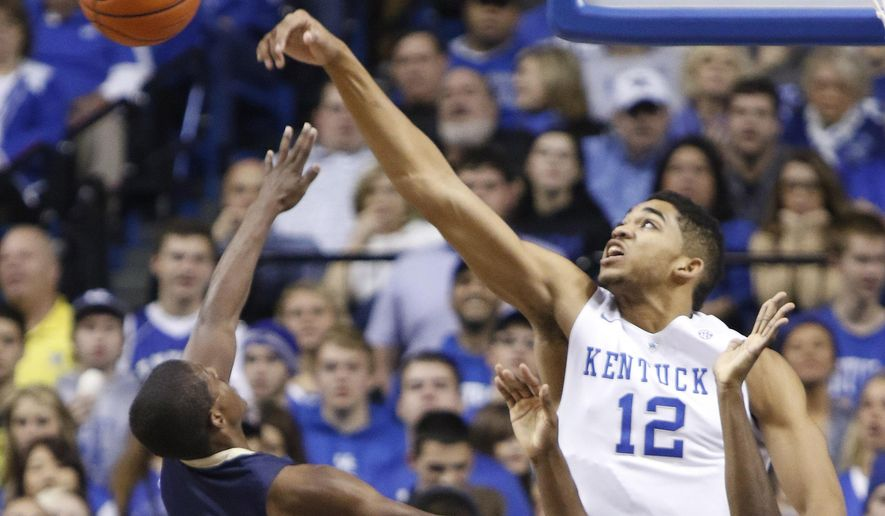 Kentucky's Karl-Anthony Towns (12) blocks the shot of Montana State's Michael Dison during the first half of an NCAA college basketball game, Sunday, Nov. 23, 2014, in Lexington, Ky. (AP Photo/James Crisp)