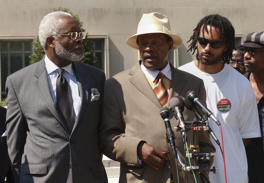 D.C. Council member Marion Barry, with his lawyer Frederick D. Cooke Jr., left, and his son, Christopher, right, speaking with reporters on June 21, 2007, after a federal judge ruled that did not violate his probation stemming from his tax problems and would not be going to jail. (Bert V. Goulait / The Washington Times)