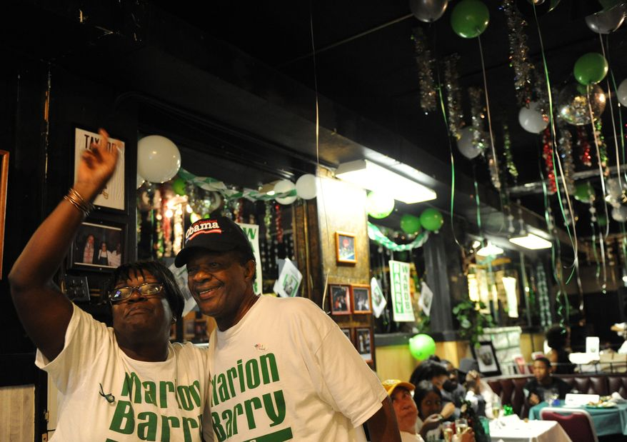 D.C. Council member Marion Barry celebrates with supporters at Players Lounge in Southeast after winning on primary night, Sept. 9, 2008. (Allison Shelley/The Washington Times)