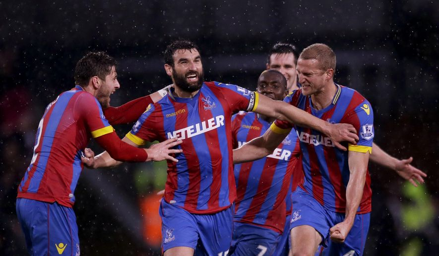 Crystal Palace's captain Mile Jedinak, second left, celebrates scoring his side's third goal with during the English Premier League soccer match between Crystal Palace and Liverpool at Selhurst Park stadium in London, Sunday, Nov. 23, 2014.  (AP Photo/Matt Dunham)