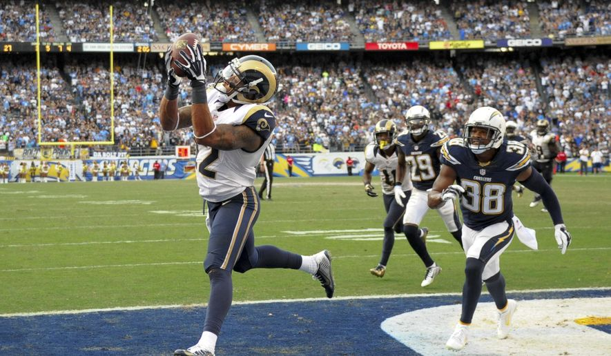 St. Louis Rams wide receiver Stedman Bailey, left, scores past San Diego Chargers strong safety Marcus Gilchrist during the second half of an NFL football game, Sunday, Nov. 23, 2014, in San Diego. (AP Photo/Denis Poroy)
