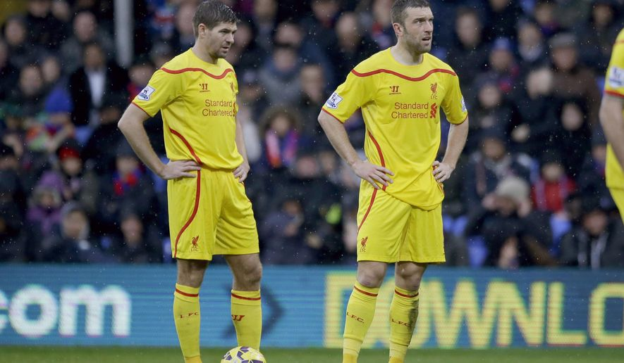 Liverpool's captain Steven Gerrard, left, and Rickie Lambert stand with their hands on their hips during the English Premier League soccer match between Crystal Palace and Liverpool at Selhurst Park stadium in London, Sunday, Nov. 23, 2014.  (AP Photo/Matt Dunham)