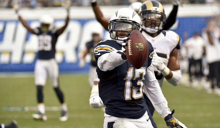San Diego Chargers wide receiver Keenan Allen celebrates after scoring against the St. Louis Rams during the second half of an NFL football game, Sunday, Nov. 23, 2014, in San Diego. (AP Photo/Denis Poroy)