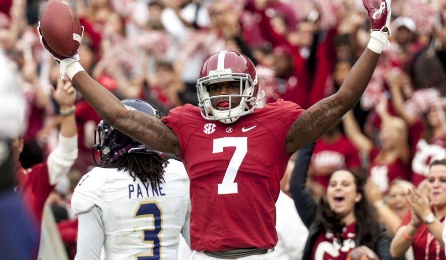 Alabama wide receiver Cam Sims (7) celebrates a touchdown during the first quarter of an NCAA college football game against Western Carolina, Saturday, Nov. 22, 2014, at Bryant-Denny Stadium in Tuscaloosa, Ala. Alabama won 48-14. (AP Photo/Alabama Media Group, Vasha Hunt)