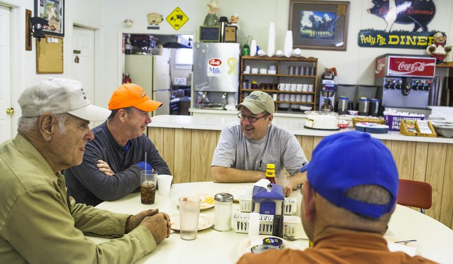 Regular customers, from left,  James Spillman,  Dwayne Sanders and Bobby Hester finish their lunch at Porky Pig Diner on Nov. 11, 2014 in Pig, Ky.  When Calvin and Ramona Durham opened Porky Pig Diner in south-central Kentucky about 19 years ago, Calvin Durham saw it as an opportunity to provide people with better food than he was used to getting when he traveled as a truck driver.  (AP Photo/Daily News, Austin Anthony)