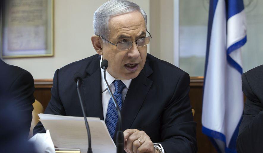 Israeli Prime Minister Benjamin Netanyahu speaks during in his Cabinet meeting in his office in Jerusalem on Sunday, Nov. 23, 2014. (AP Photo/Jim Hollander, Pool)