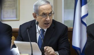 Israeli Prime Minister Benjamin Netanyahu speaks during in his Cabinet meeting in his office in Jerusalem on Sunday, Nov. 23, 2014. (AP Photo/Jim Hollander, Pool)