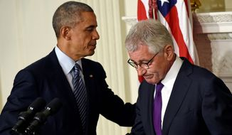 No hard feelings: President Obama shakes hands with Defense Secretary Chuck Hagel after announcing Mr. Hagel's resignation Monday. Mr. Hagel is the third defense secretary to resign during Mr. Obama's six years in the White House. (associated press)