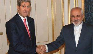 U.S. Secretary of State John Kerry shakes hands with Iranian Foreign Minister Mohammad Javad Zarif, right, prior to a bilateral meeting of the closed-door nuclear talks with Iran in Vienna, Austria, Sunday, Nov. 23, 2014. The U.S. and five other nations trying to negotiate a nuclear deal with Iran are turning away from attempting to reach an agreement by deadline and have started internal discussions on extending the talks, diplomats said Sunday. (AP Photo/Ronald Zak, pool)