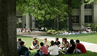 Groups of incoming freshmen meet with each other and their orientation leader on the campus greens during American University's summer orientation session for incoming freshman in Washington, DC, on Monday, July 10, 2006. ( Katie Falkenberg / The Washington Times )