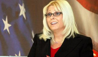 This undated handout photo provided by The Veterans Affairs Department, shows Sharon Helman, director of the Phoenix VA Health Care System.   Helman was fired Monday, nearly seven months after she and two high-ranking officials were placed on administrative leave amid allegations that 40 veterans died while awaiting treatment at the hospital. Helman had led the Phoenix facility since February 2012.  Best quality available.   (AP Photo/Veterans Affairs Department)