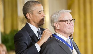 President Barack Obama awards journalist, Tom Brokaw, the Presidential Medal of Freedom, Monday, Nov. 24, 2014, during a ceremony in the East Room of the White House in Washington. (AP Photo/Pablo Martinez Monsivais)