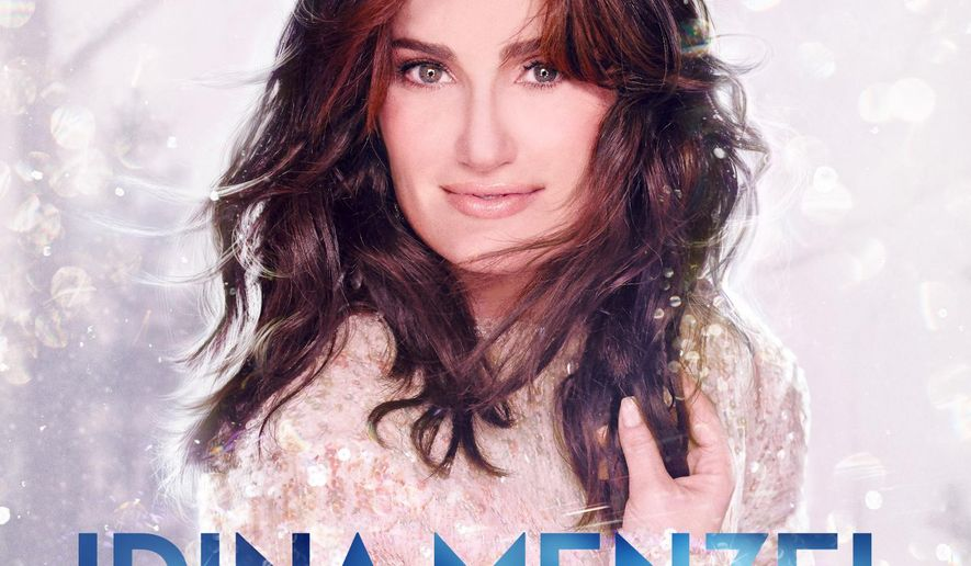 """This CD cover image released by Warner Bros. Records shows """"Holiday Wishes,"""" by Idina Menzel. Menzel brings the soaring voice that made her famous this year in the Disney hit movie to her Christmas album """"Holiday Wishes."""" The Tony Award-winner puts her own spin on holiday classics like """"Silent Night"""" and """"Do You Hear What I Hear?"""" (AP Photo/Warner Bros. Records)"""