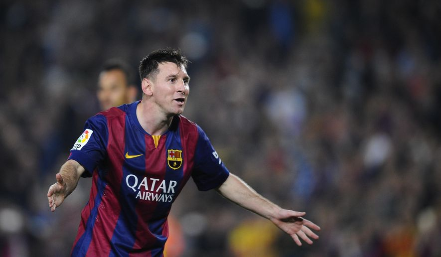 FC Barcelona's Lionel Messi, from Argentina, celebrates, after scoring against Sevilla during a Spanish La Liga soccer match between FC Barcelona and Sevilla,  at the Camp Nou stadium in Barcelona, Spain, Saturday, Nov. 22, 2014.  Messi set a La Liga scoring record of 253 goals when he claimed a hat-trick in Saturday's match at the Camp Nou stadium against Sevilla. (AP Photo/Manu Fernandez)
