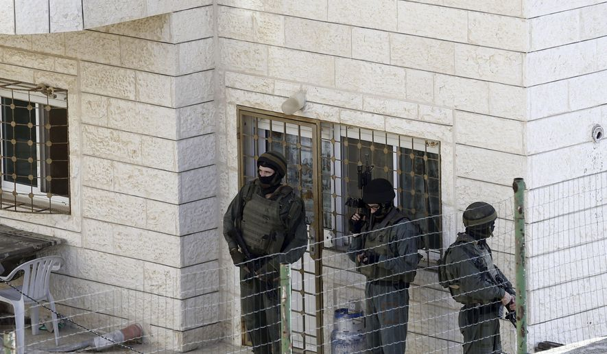 File - In this Nov. 18, 2014 file photos Israeli police stand guard outside the home of cousins Ghassan and Oday Abu Jamal in east Jerusalem. The Abu Jamal cousins stormed a Jerusalem synagogue on Tuesday, attacking worshippers with meat cleavers and a gun during morning prayers killing four people and a policeman. The family received a notice from the Israeli authorities that their house will be razed. Israel says it is resuming demolitions because it needs more tools to stop a recent wave of Palestinian attacks on Jews. (AP Photo/Mahmoud Illean, File)