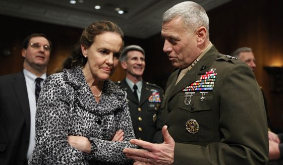 Defense Undersecretary for Policy Michele Flournoy, left,  talks with Marines Lt. Gen. John Paxton, director for operations, the Joint Staff, talk on Capitol Hill in Washington, Monday, Feb. 22, 2010, prior to their testifying before the Senate Armed Services Committee hearing on Afghanistan.  (AP Photo/Manuel Balce Ceneta)