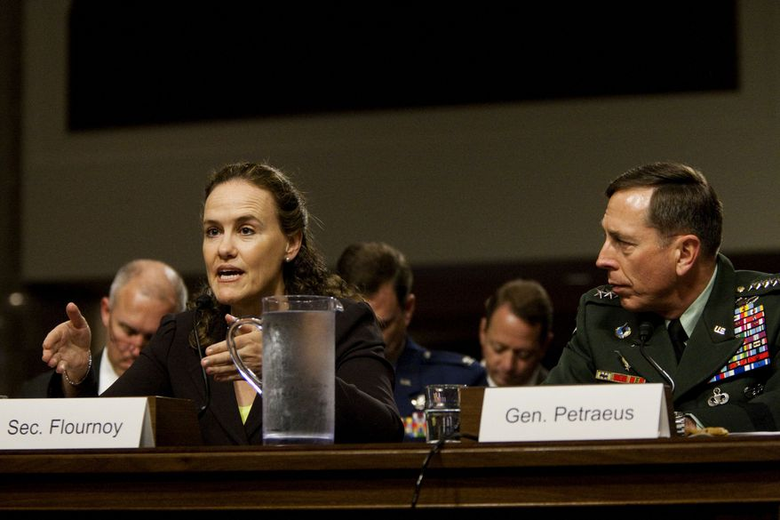 U.S. Central Commander Gen. David Petraeus looks on at right as Defense Undersecretary Michele Flournoy testifies on Capitol Hill in Washington, Wednesday, June 16, 2010, before the Senate Armed Services Committee hearing on Afghanistan. (AP Photo/Drew Angerer)