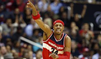 Washington Wizards forward Paul Pierce (34) celebrates a basket in the first half of an NBA basketball game against the Cleveland Cavaliers, Friday, Nov. 21, 2014, in Washington. (AP Photo/Alex Brandon)