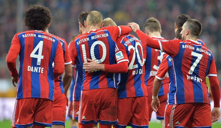 Bayern's players celebrate after scoring during the  Bundesliga  soccer match between FC Bayern Munich and 1899 Hoffenheim in the Allianz Arena in Munich, Germany, on Saturday, Nov. 22, 2014.  (AP Photo/Kerstin Joensson)