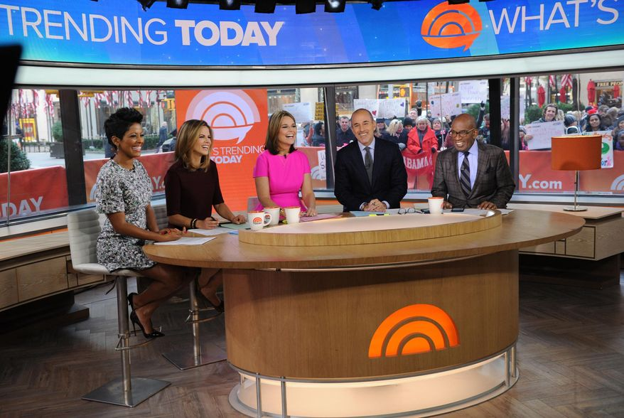"""In this Monday, Nov. 3, 2014 photo provided by NBC, from left, Tamron Hall, Natalie Morales, Savannah Guthrie, Matt Lauer, and Al Roker appear on the """"Today"""" show, in New York. (AP Photo/NBC, Bryan Bedder)"""