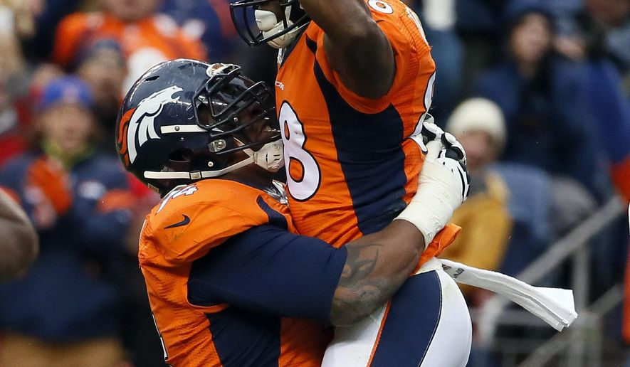Denver Broncos wide receiver Demaryius Thomas (88) celebrates his touchdown against the Miami Dolphins during the first half of an NFL football game, Sunday, Nov. 23, 2014, in Denver. (AP Photo/Jack Dempsey)